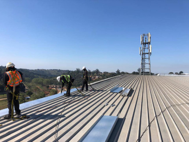 Tradies working on a rooftop
