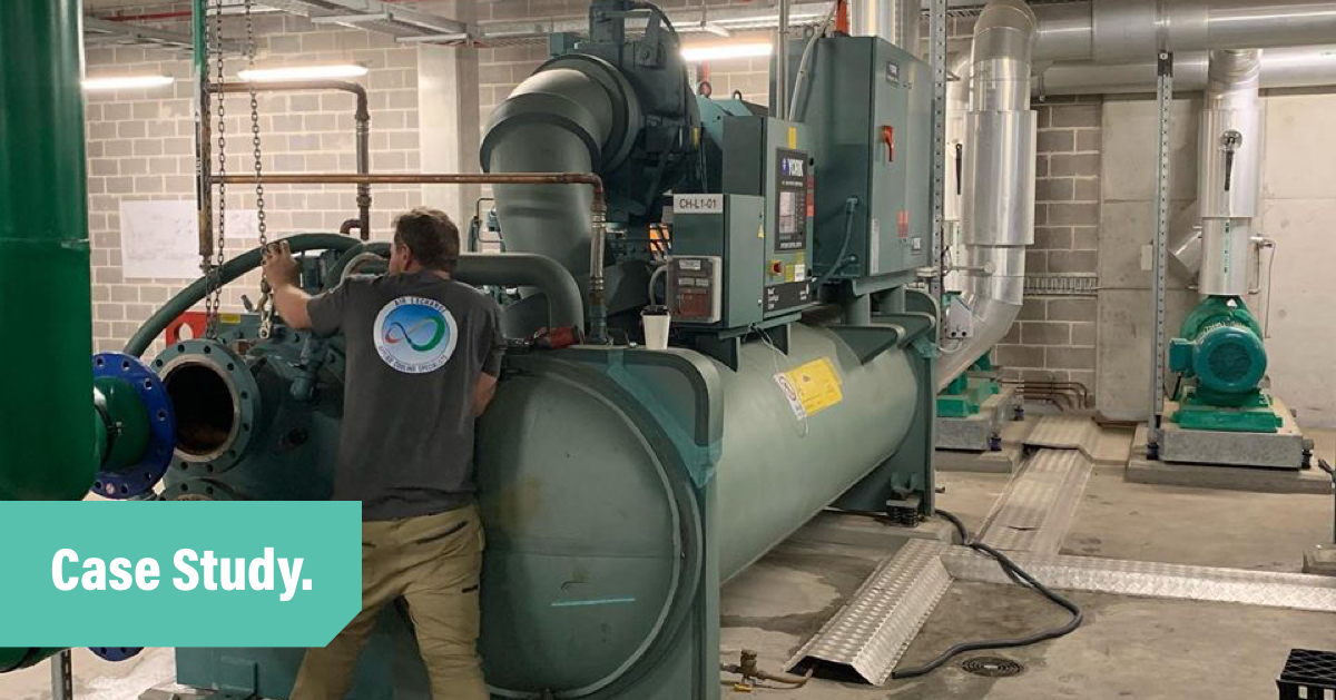 Air Exhange employee works on an industrial sized chiller unit