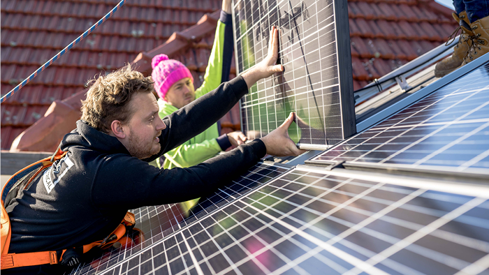 Blog-How To Grow A Small Electrical Business-two electricians installing solar panels on roof