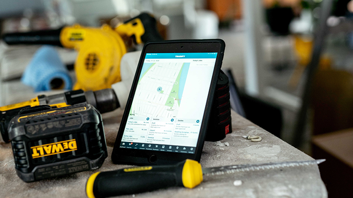 closeup of tablet showing map next to DeWALT drill and knife