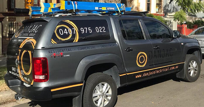 Danjac electrical ute with brand signage