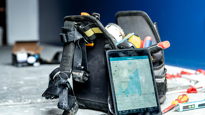 closeup of tool bag with tablet leaning against it