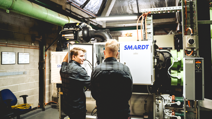 two men looking at a SMARDT air cooling unit