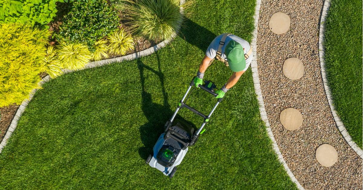 Aerial shot of man mowing lawns