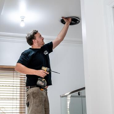 electrician installing a downlight