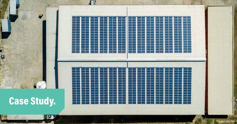 Aerial shot of a large solar panel with the words Case Study overlayed