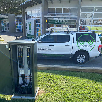 A tradesperson's ute parked at a school to work on a power box