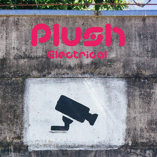 A painted Plus Electrical sign on a bare concrete wall