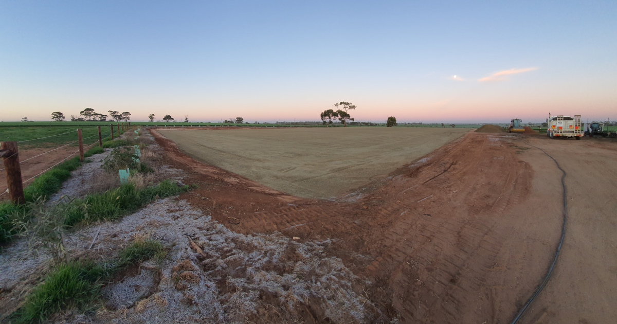 Moving earth in a field on a beautiful morning at dawn