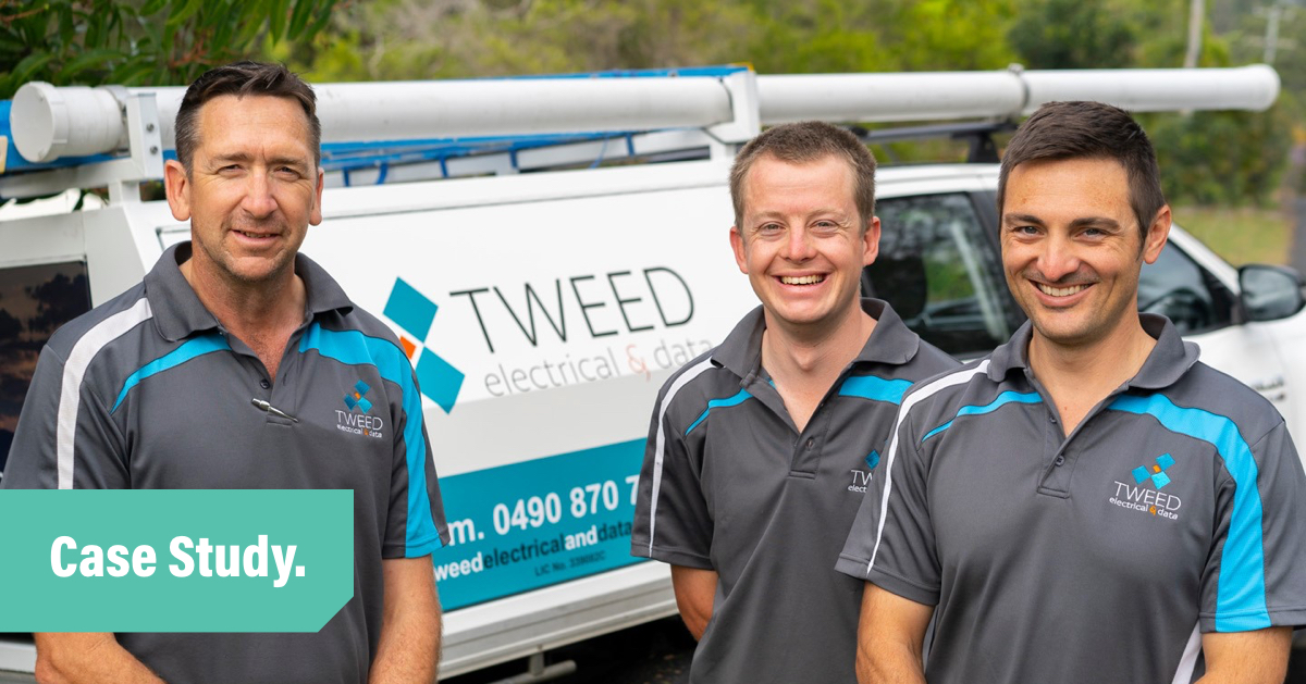 Three men from The Tweed Electrical team standing in front of a company vehicle and smiling