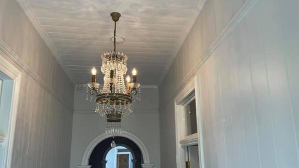 CaseStudy_matt_hill_electrical_luxury teardrop chandelier hanging from ceiling