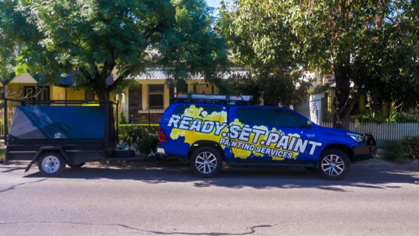 Customer Story_Ready Set Paint_Blue ute with ready set paint logo towing a trailer