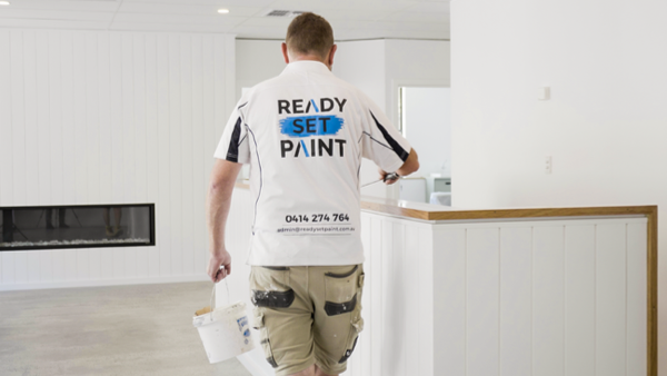 Customer Story_Ready Set Paint_painter in white shirt with a paint bucket