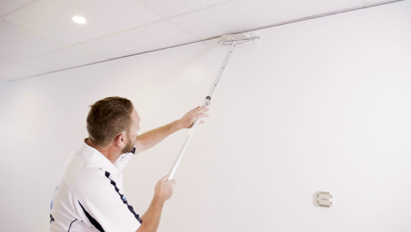 Customer Story_Ready Set Paint_painter in white t-shirt painting a white wall