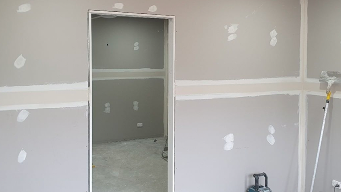 empty room with freshly plastered walls