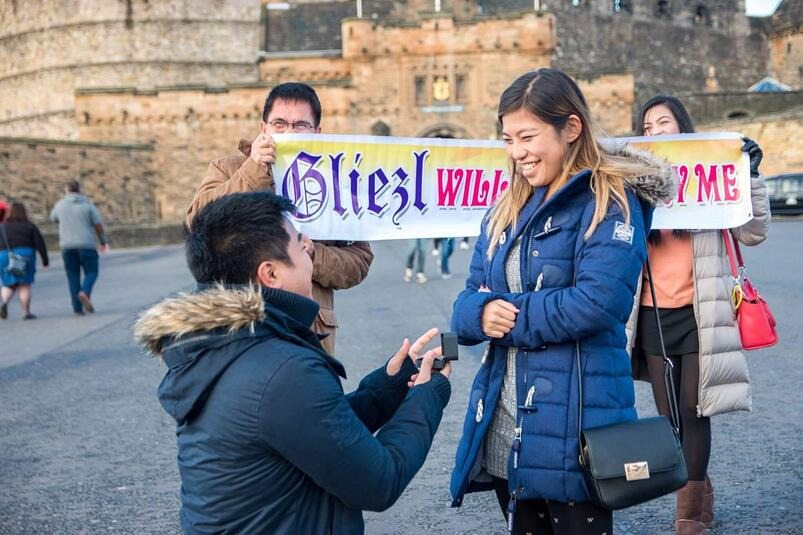 Deana's brother proposes to his girlfriend in front of a castle