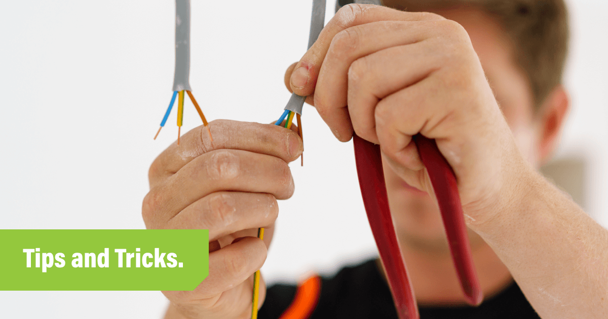 Electrician testing wires as part of EICR checklist