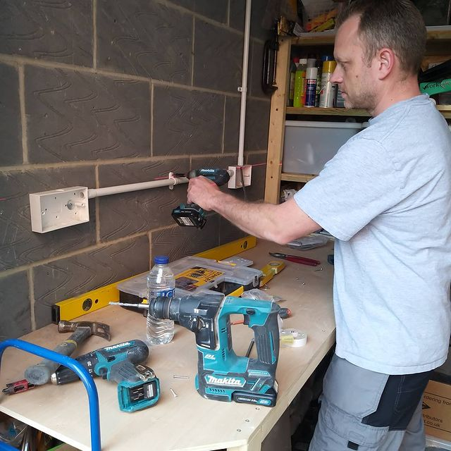 grant speller from Essex County Electrical on the job with makita power tools