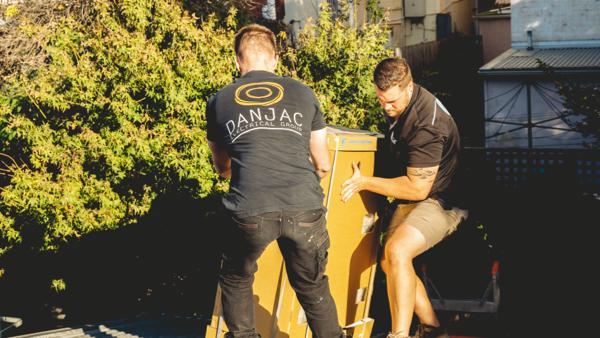 Flat Rate vs Hourly_danjac electrical carrying big cardboard box