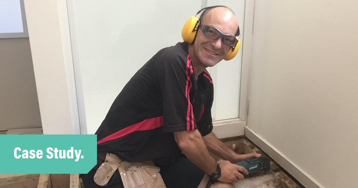 Customer story blog header with an a photo of Handy Andy wearking safety goggles and yellow ear muffs