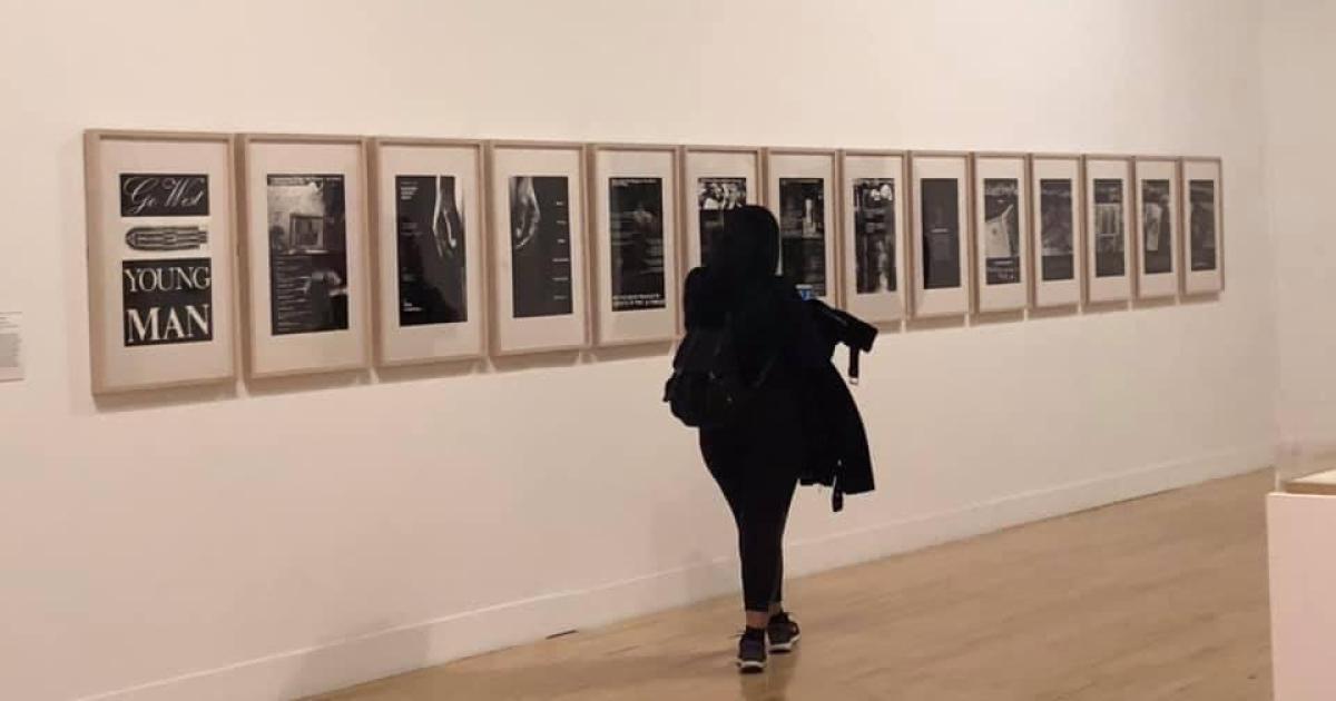 Jordyn looking at art in an art gallery