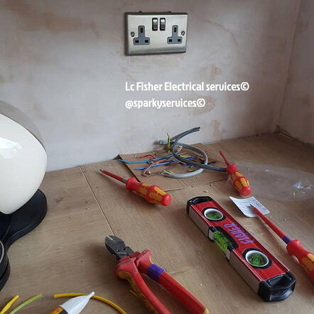 A photo of a newly installed silver coloured double power point with red tools on the floor