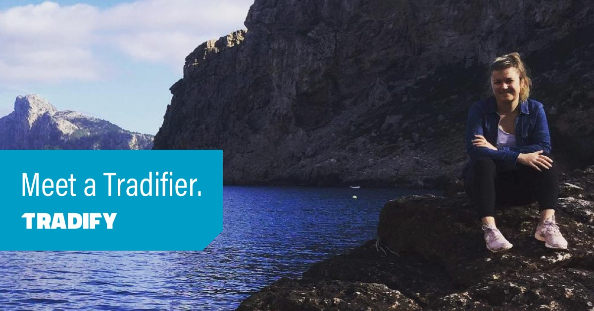 Meet a Tradifier heading with a photo of Charlie perched on a rock at the edge of water