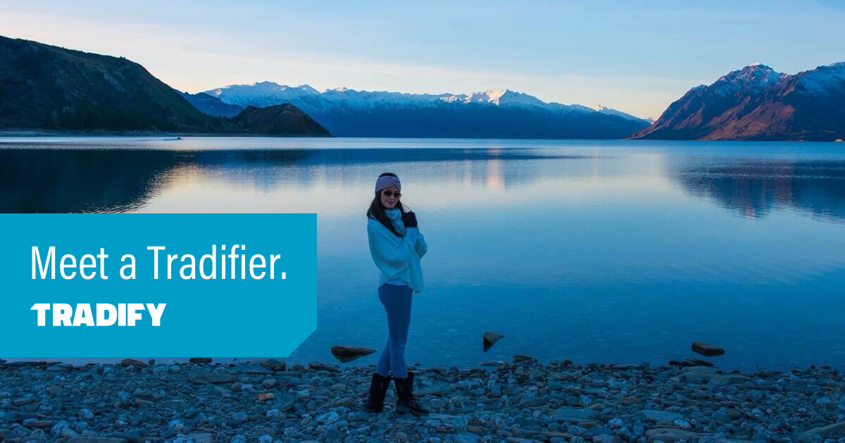 Meet a Tradifier heading with a  photo of Deana standing next to a beautiful big lake