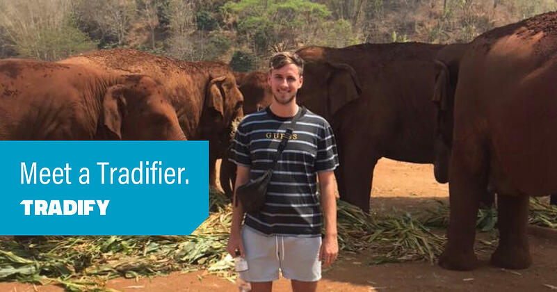 Meet a Tradifier heading with a photo of Ed posing with elephants