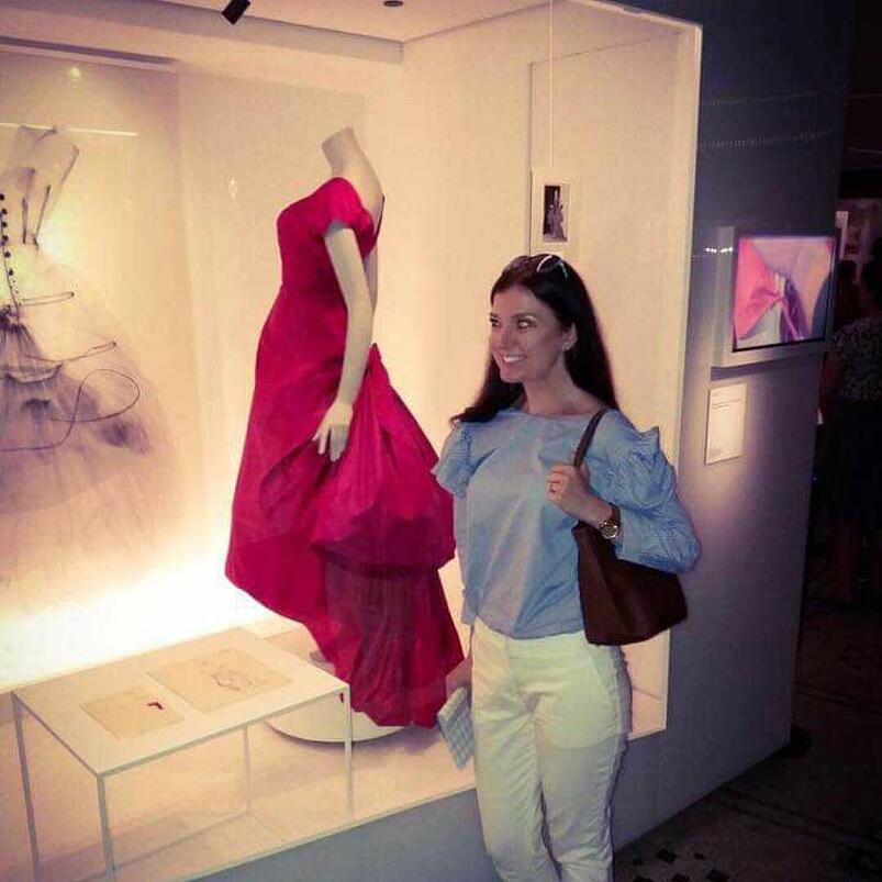 Marta looks very happy while visiting a fashion exhibition