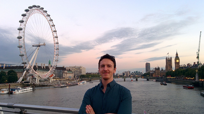 man standing infront of the London Eye