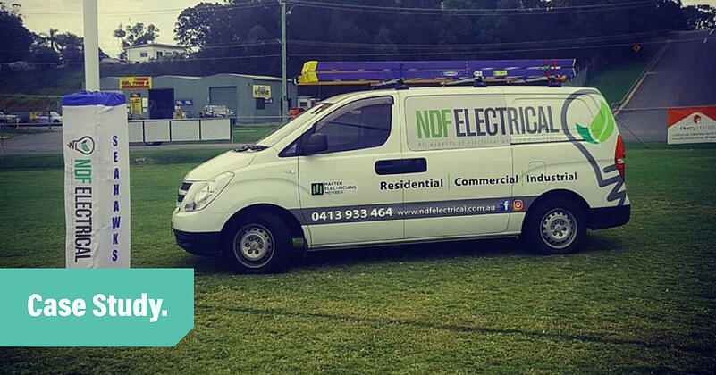 A white NDF Electrical van parked under the goal post on a rugby field