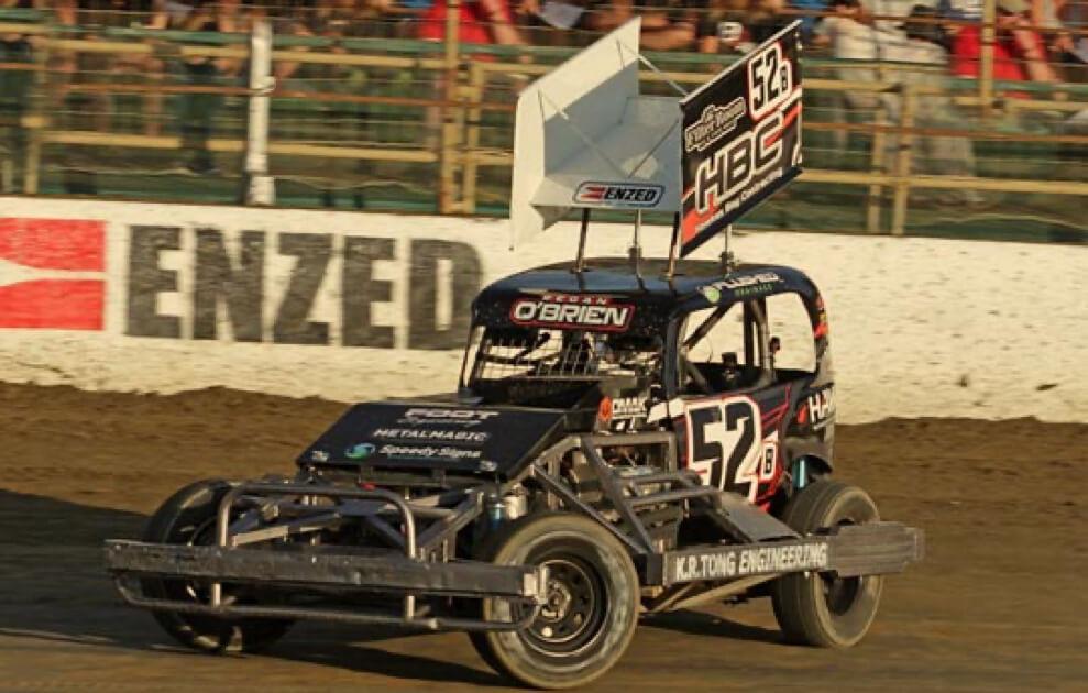 Regan O'Brien's black stock car number 52 on the race track