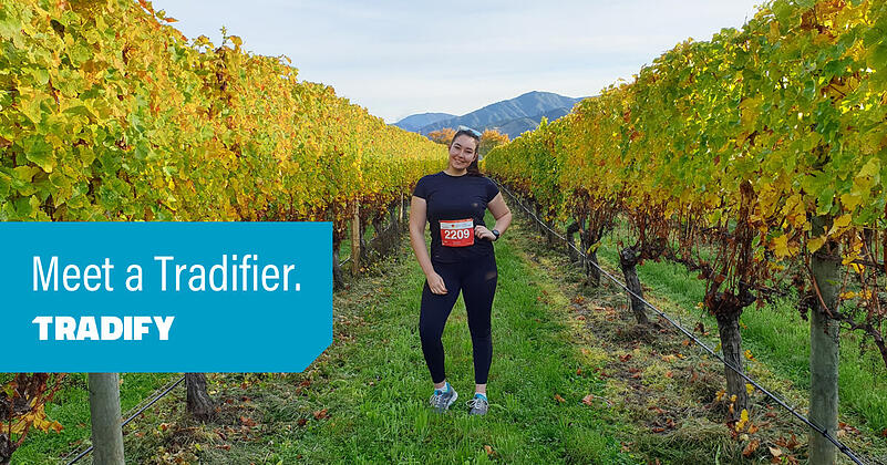 Odette stands in a vineyard, about to do a running race