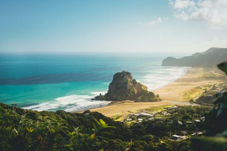 Looking down at Piha Beach and Lion Rock with beautiful blue ocean