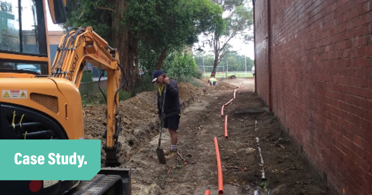 Richie's Electrical Tradify Case Study blod header with a photo of Richie laying cable in a trench