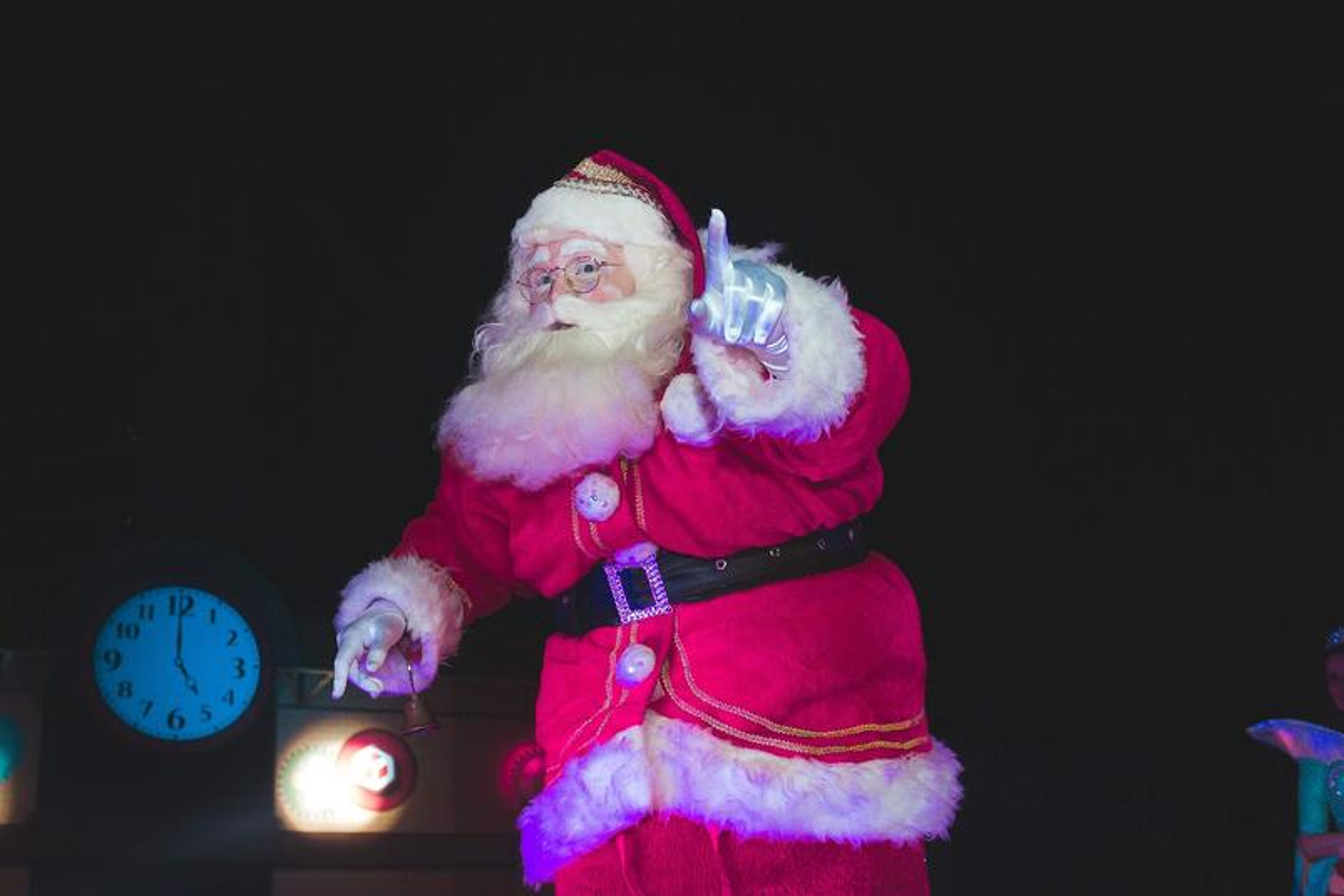 Santa clause at 5am on a dark morning, pointing at the sky