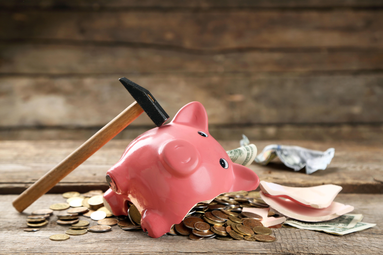 piggy bank broken with hammer