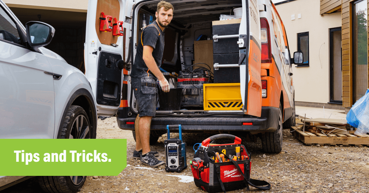 Tradies standing outside his van with electrical tools