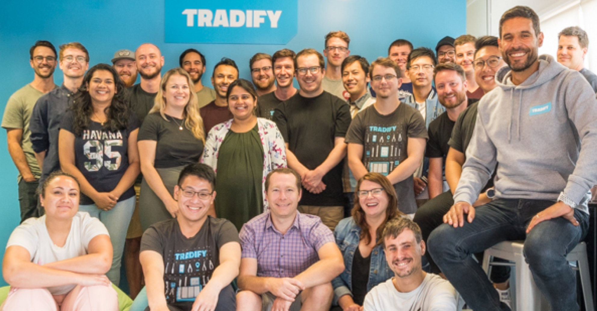The smiling Tradify team