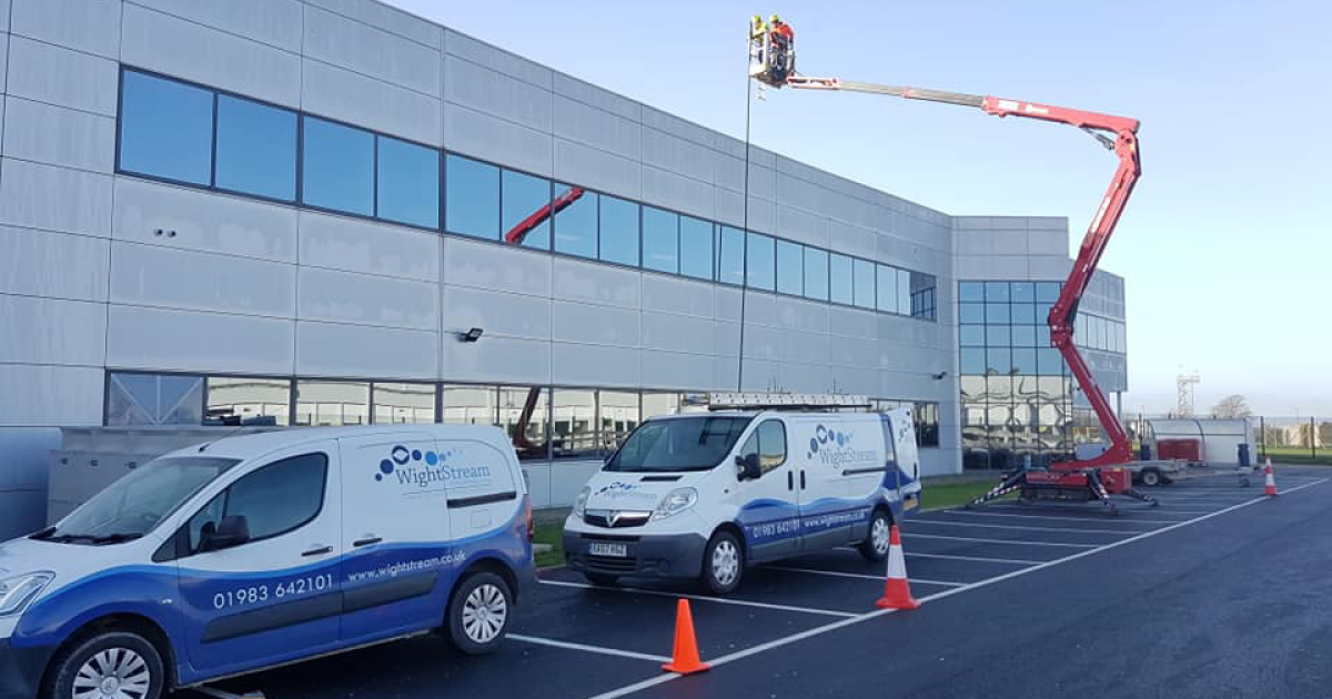 wightstream vans lined up against building