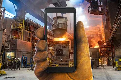 A hand in a welder's glove holding the Samsung GalaxyXCover5 phone