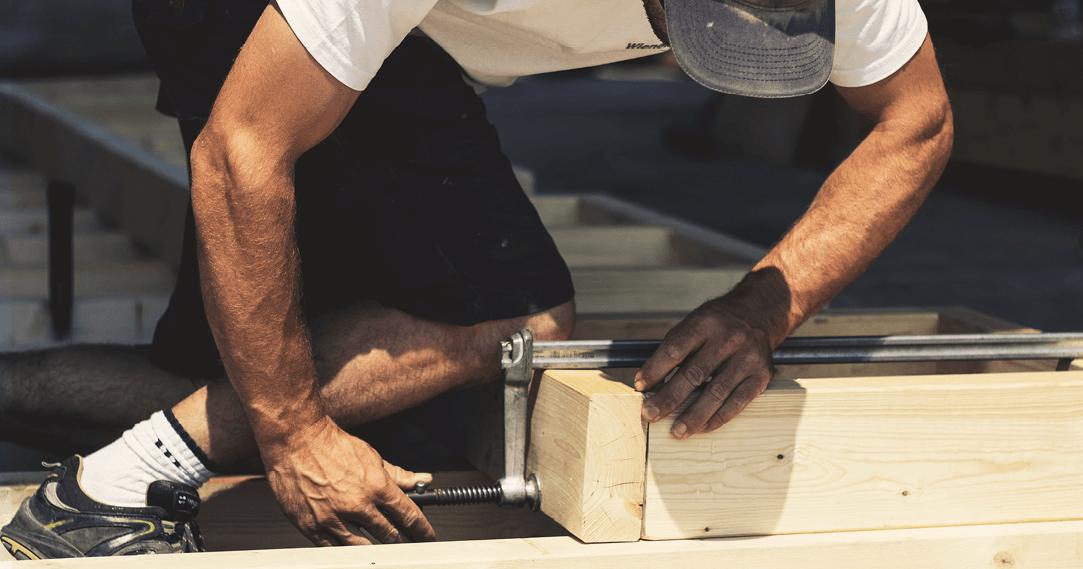 carpenter using g clamp