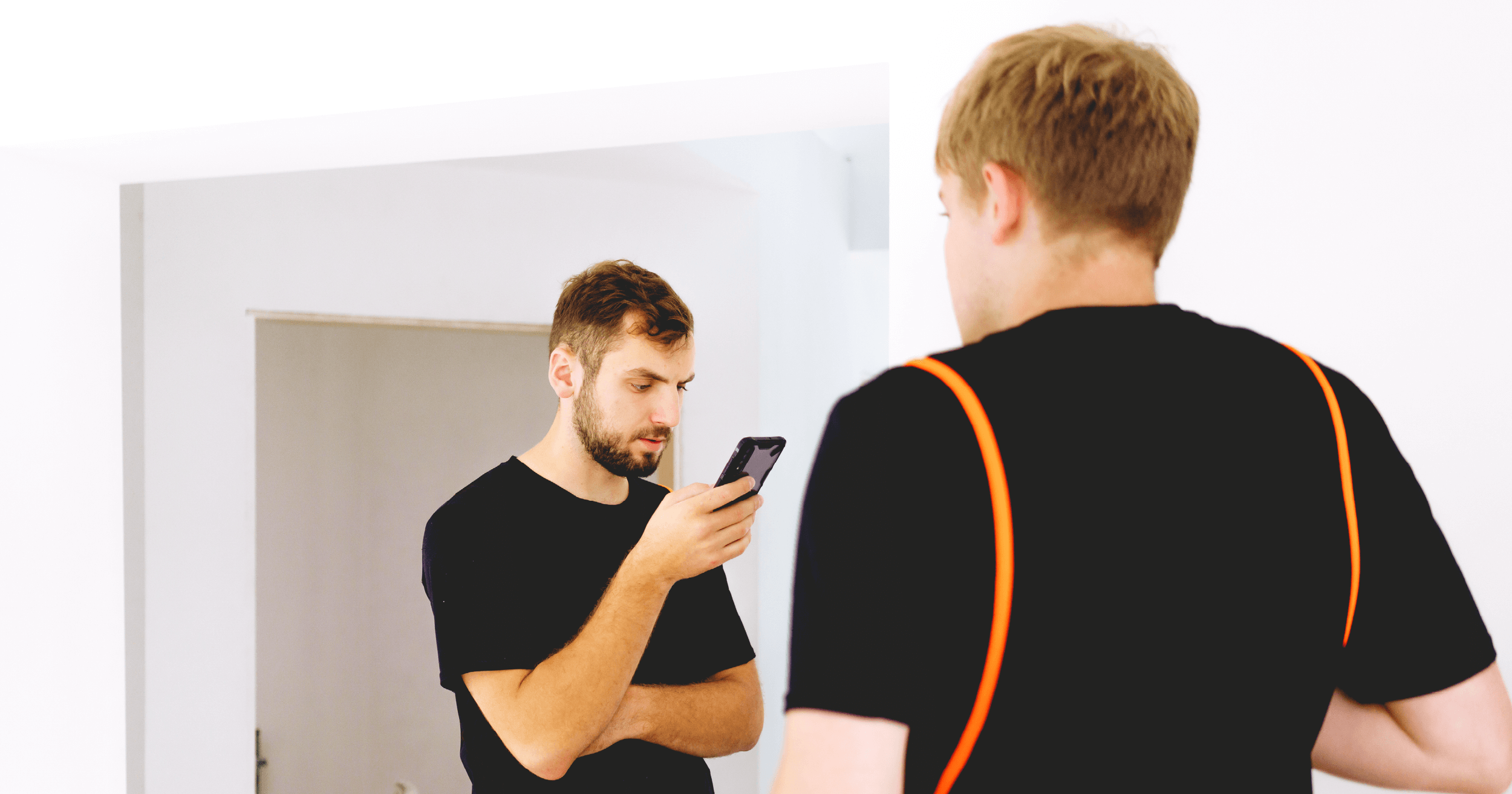 blog_bodyimage_health and safety inspector looking at his phone