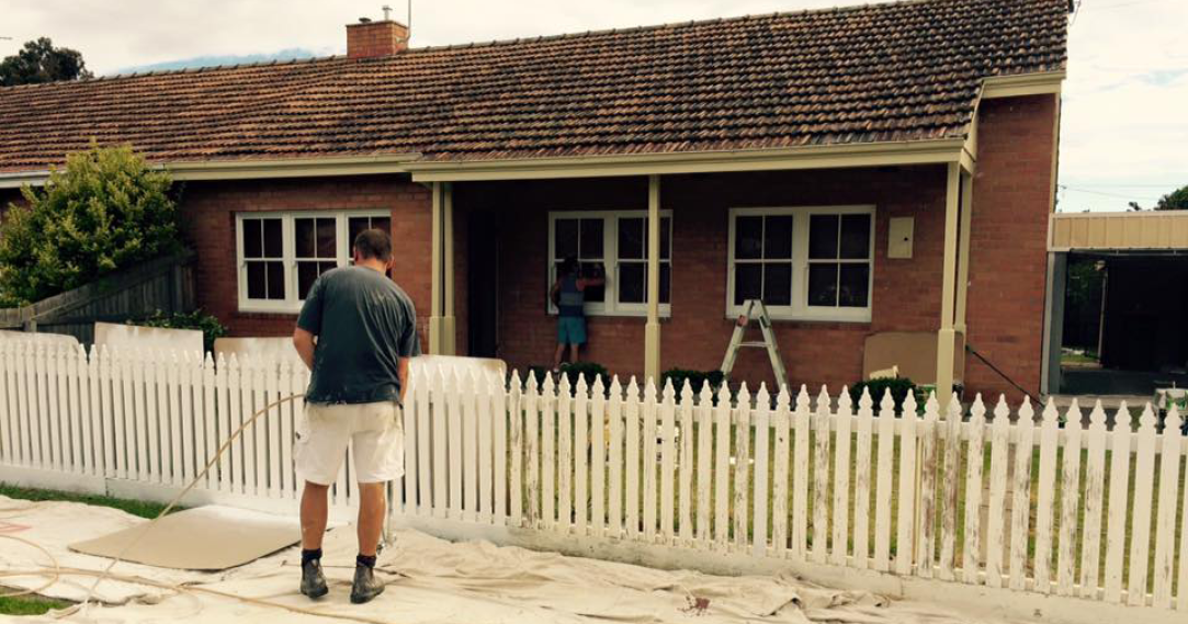 master painters_painting a white picket fence