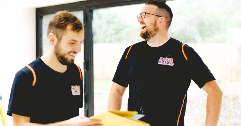 dan from dss electrical laughing with his apprentice