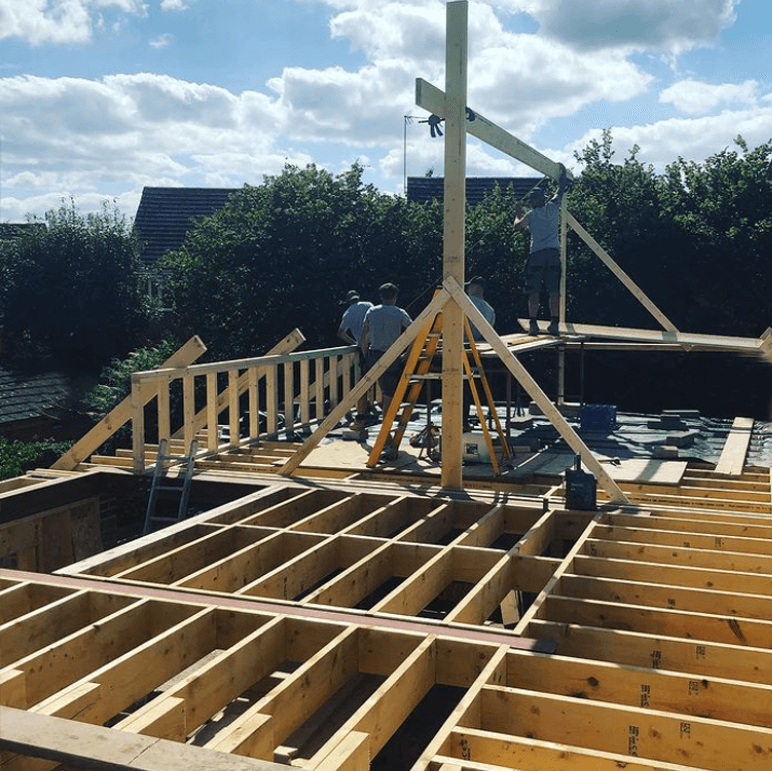 Builders at Green Hawk construction working on a house build
