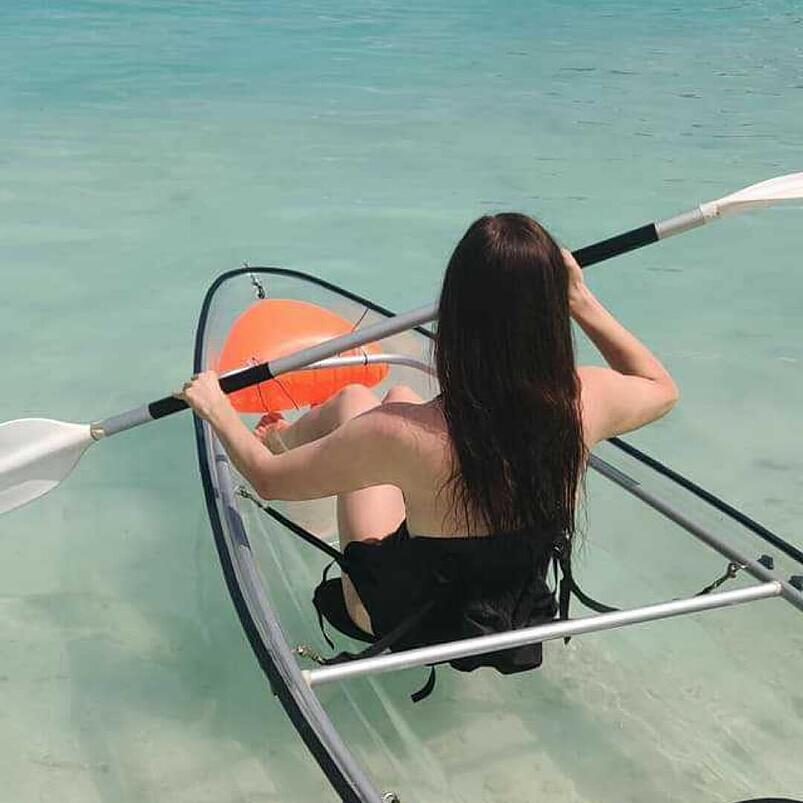 Marta rowing in a clear bottomed kayak