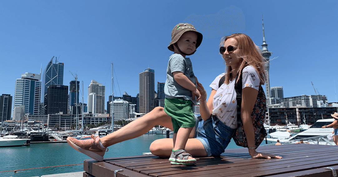 mat_alena_alena and her son in front of auckland city skyline view from wynyard quarter