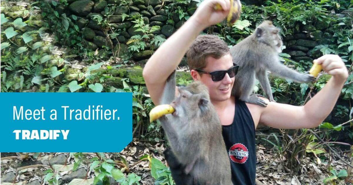 Meet a Tradifier heading over a photo of Andrew feeding bananas to monkeys